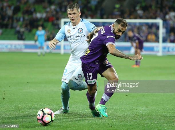 Diego Castro of Perth Glory is challenged by Michael Jakobsen of Melbourne City during the ALeague Elimination Final match between Melbourne City FC...