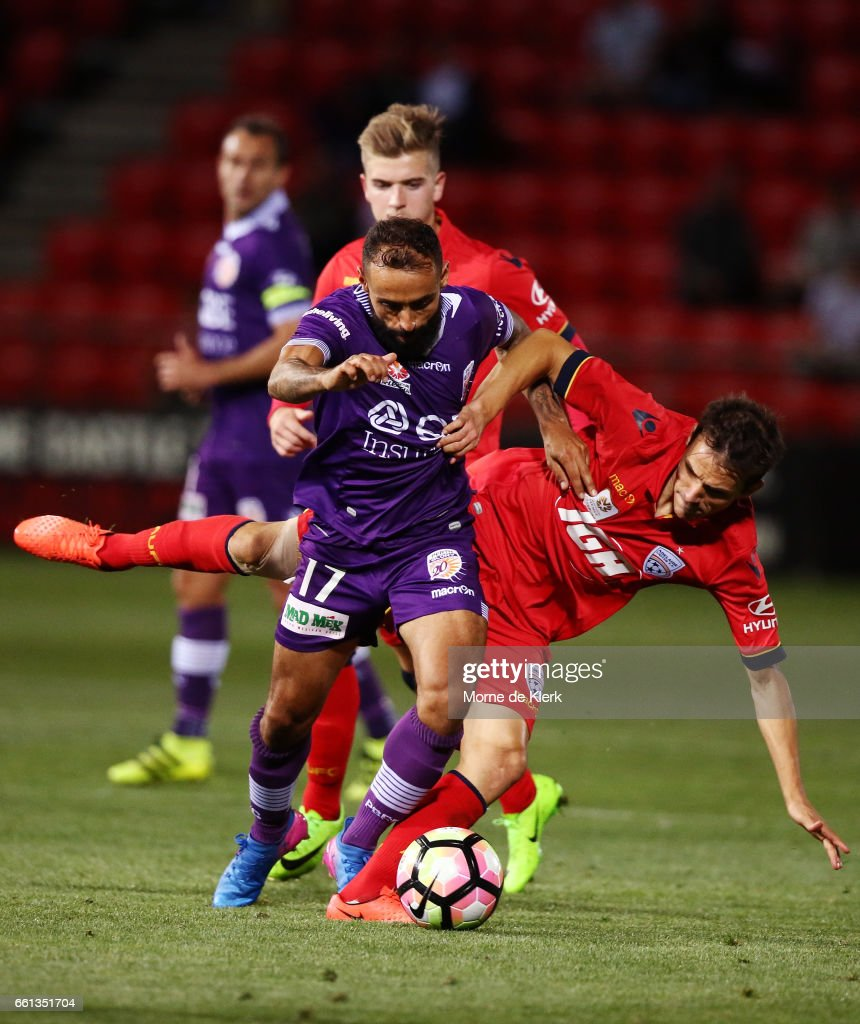 Diego Castro of Perth Glory is tackled by Isaas of Adelaide United during the round 25 A-League match between Adelaide United and Perth Glory at Coopers Stadium on March 31, 2017 in Adelaide, Australia.