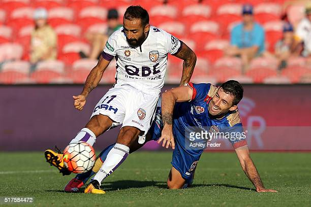 Diego Castro of Perth Glory is tackled by Jason Hoffman of the Jets during the round 25 ALeague match between the Newcastle Jets and the Perth Glory...
