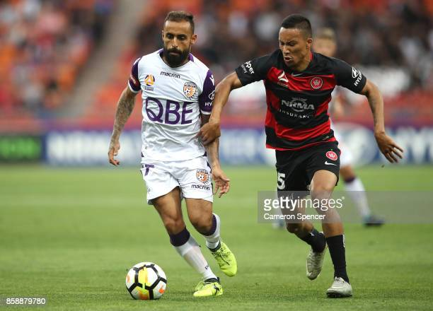Diego Castro of the Glory and Kearyn Baccus of the Wanderers contest the ball during the round one ALeague match between the Western Sydney Wanderers...