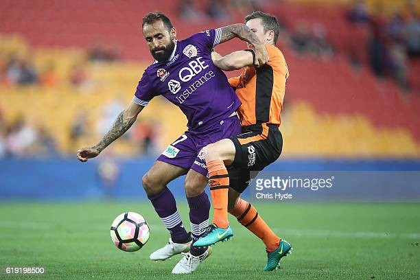 Diego Castro of the Glory and Matthew Mckay of the Roar compete for the ball during the round four ALeague match between the Brisbane Roar and Perth...