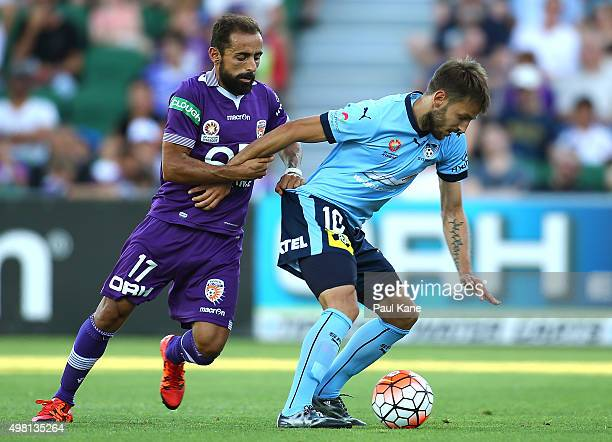 Diego Castro of the Glory and Milos Ninkovic of Sydney contest for the ball during the round seven ALeague match between Perth Glory and Sydney FC at...