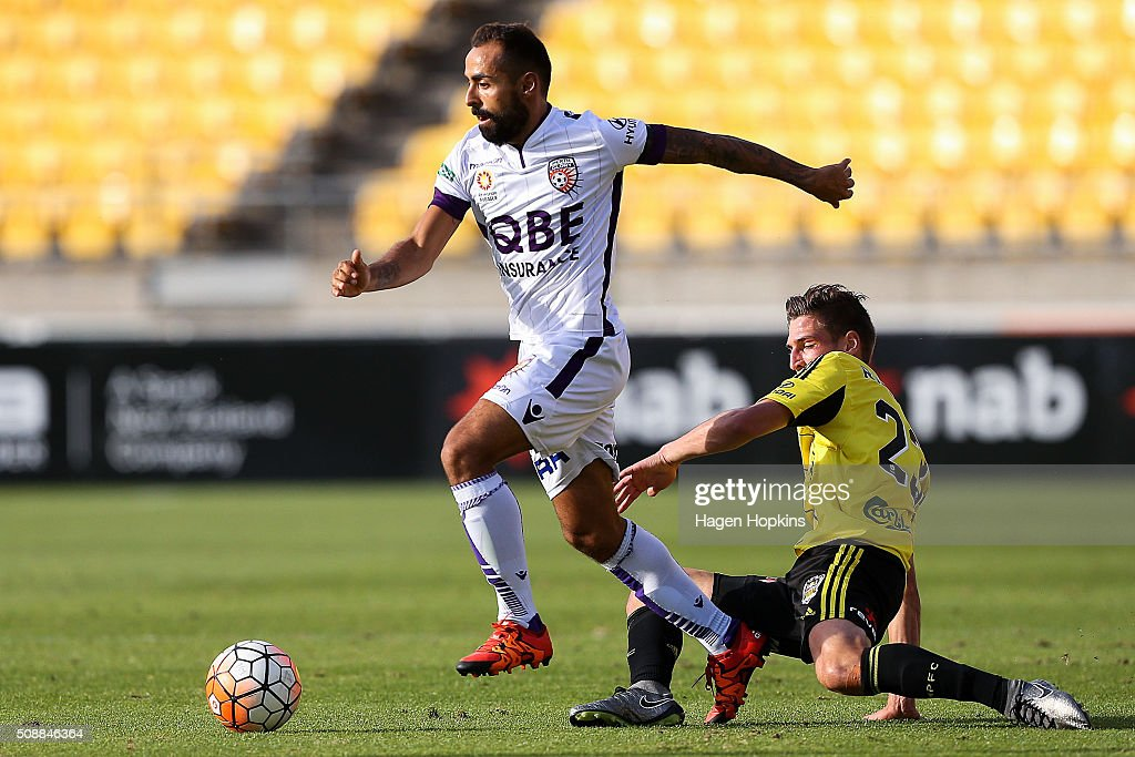 Diego Castro of the Glory beats the challenge of Matthew Ridenton of the Phoenix during the round 18 A-League match between Wellington Phoenix and Perth Glory at Westpac Stadium on February 7, 2016 in Wellington, New Zealand.