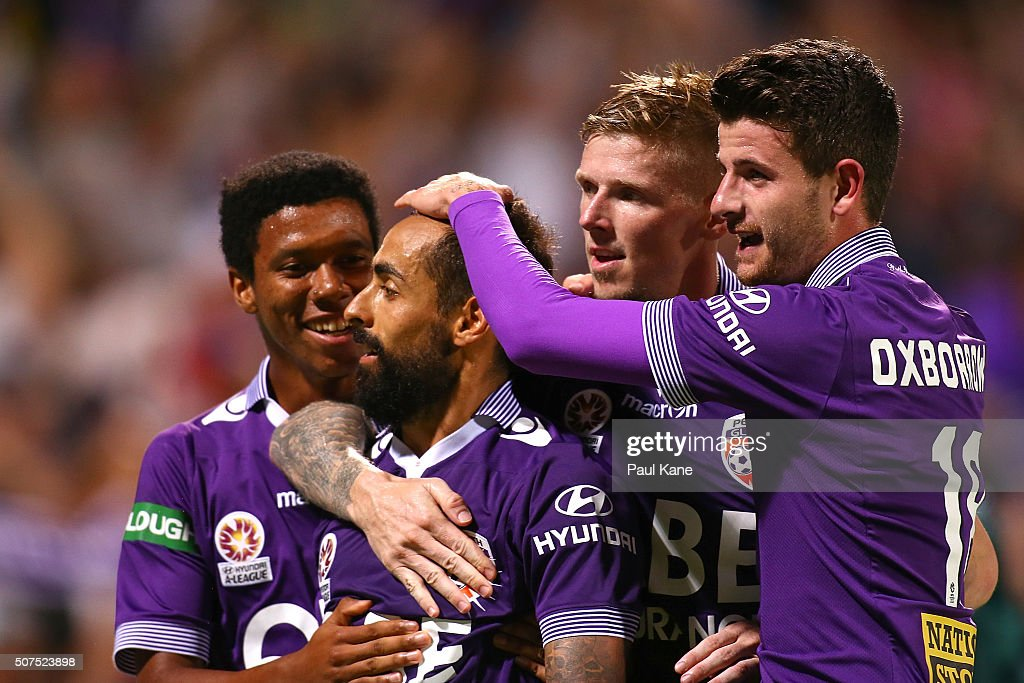 Diego Castro of the Glory celebrates a goal from a penalty kick with Jamal Reiners, Andy Keogh and Mitchell Oxborrow during the round 17 A-League match between Perth Glory and Melbourne Victory at nib Stadium on January 30, 2016 in Perth, Australia.