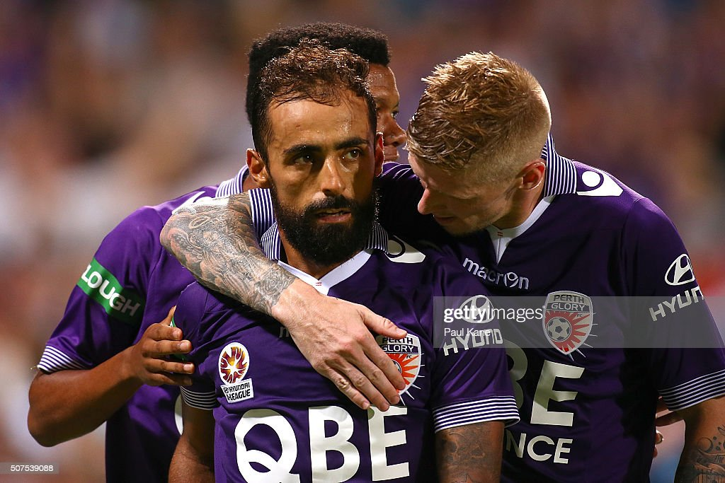 Diego Castro of the Glory celebrates a goal from a penalty kick with Jamal Reiners and Andy Keogh during the round 17 A-League match between Perth Glory and Melbourne Victory at nib Stadium on January 30, 2016 in Perth, Australia.