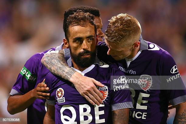 Diego Castro of the Glory celebrates a goal from a penalty kick with Jamal Reiners and Andy Keogh during the round 17 ALeague match between Perth...
