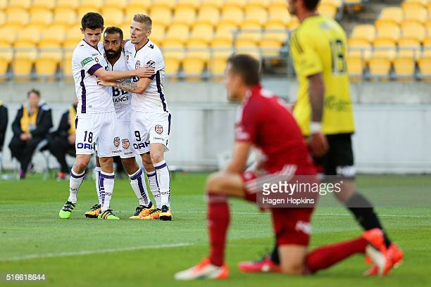 Diego Castro of the Glory celebrates his goal with Mitchell Oxborrow and Andy Keogh while Glen Moss of the Phoenix looks on during the round 24...