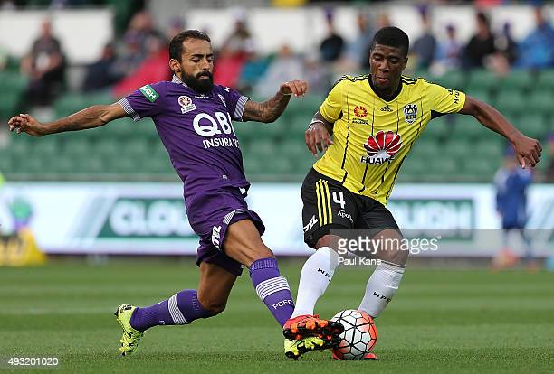 Diego Castro of the Glory challenges Roly Bonevacia of the Phoenix during the round two ALeague match between the Perth Glory and Wellington Phoenix...