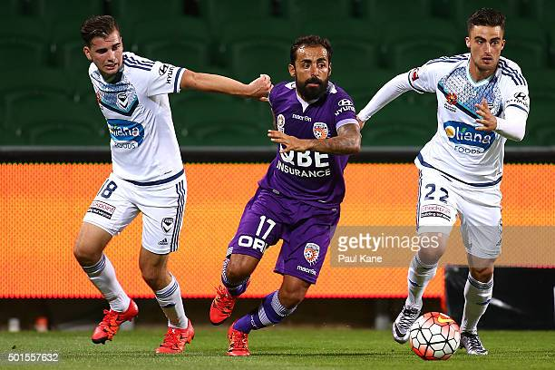 Diego Castro of the Glory contests for the ball against Dylan Murnane and Jesse Makarounas of the Victory during the round five ALeague match between...