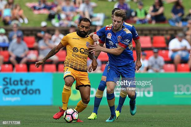 Diego Castro of the Glory contests the ball against Andrew Hoole of the Jets during the round 15 ALeague match between the Newcastle Jets and the...