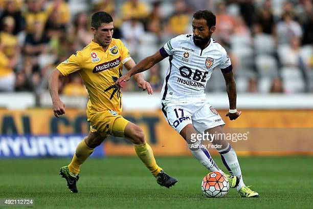 Diego Castro of the Glory contests the ball against Nick Montgomery of the Mariners during the round one ALeague match between the Central Coast...