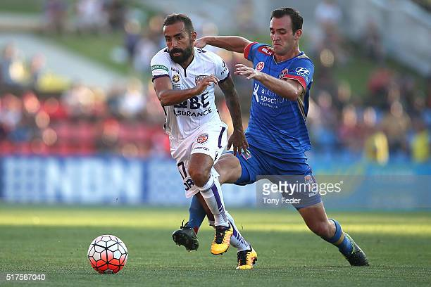 Diego Castro of the Glory contests the ball with Benjamin Kantarovski of the jets during the round 25 ALeague match between the Newcastle Jets and...