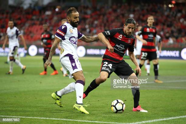 Diego Castro of the Glory contests the ball with Raul Llorente of the Wanderers during the round one ALeague match between the Western Sydney...