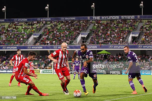 Diego Castro of the Glory controls the ball against Aaron Mooy of Melbourne during the round 26 ALeague match between the Perth Glory and Melbourne...