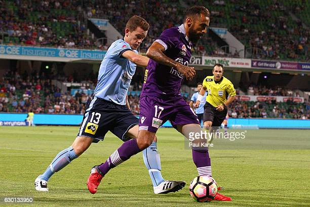 Diego Castro of the Glory controls the ball against Brandon O'Neill of Sydney during the round 11 ALeague match between Perth Glory and Sydney FC at...