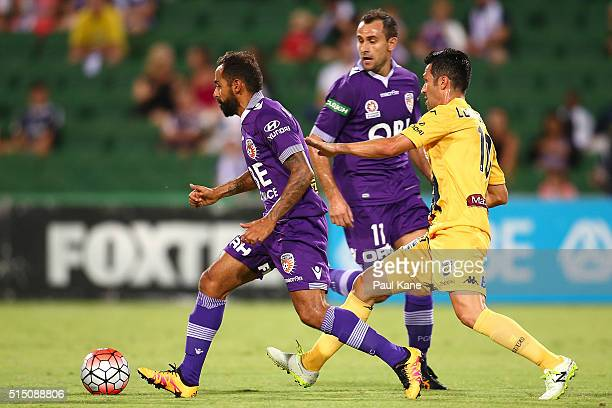 Diego Castro of the Glory controls the ball against Luis Garcia of the Mariners during the round 23 ALeague match between the Perth Glory and the...