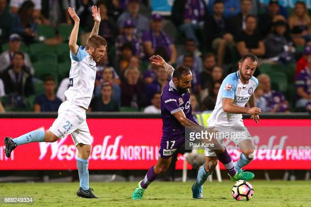 Diego Castro of the Glory controls the ball against Luke Brattan and Ivan Franjic of Melbourne during the round 27 ALeague match between the Perth...