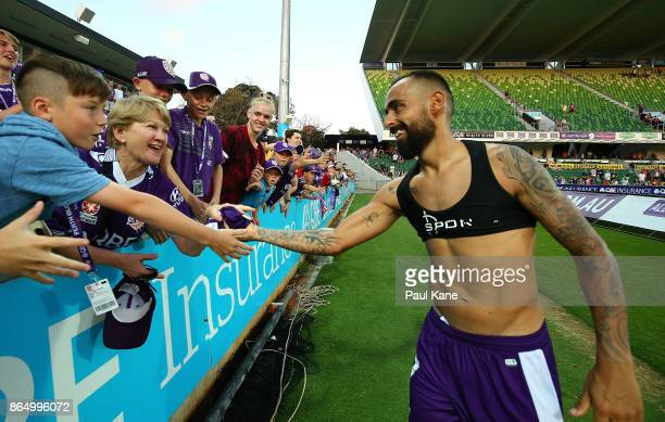 Diego Castro of the Glory hands his playing top to a supporter after winning the round three ALeague match between Perth Glory and the Central Coast...