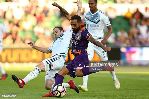 Diego Castro of the Glory has a shot on goal against Leigh Broxham of the Victory during the round 16 ALeague match between Perth Glory and Melbourne...