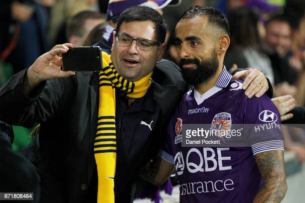 Diego Castro of the Glory poses for a selfie with a Glory fan after the ALeague Elimination Final match between Melbourne City FC and the Perth Glory...