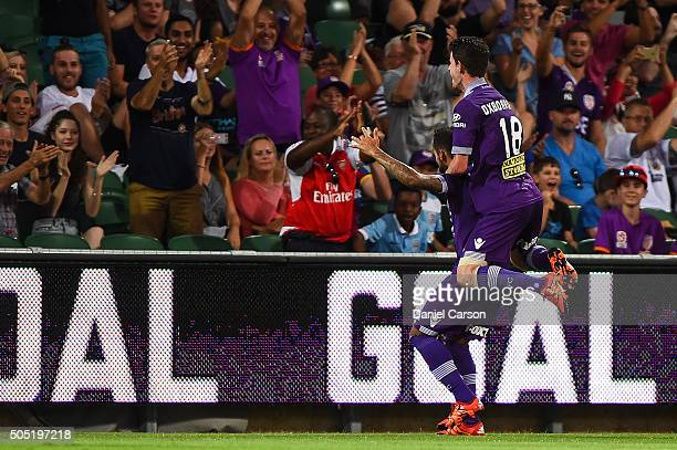 Diego Castro of the Perth Glory celebrates a goal with Mitchell Oxborrow of the Perth Glory on his back during the round 15 ALeague match between...