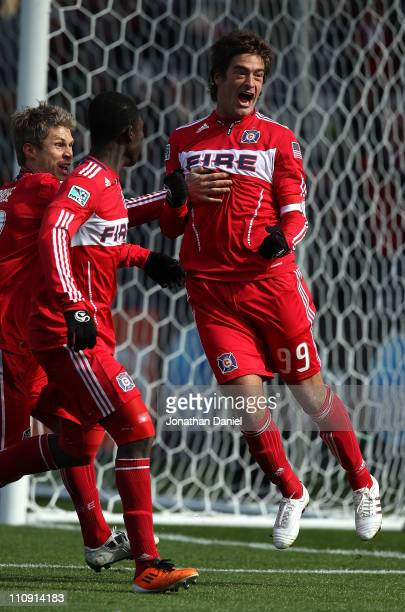 Diego Chaves of the Chicago Fire celebrates a penalty kick goal with teammates Logan Pause and Patrick Nyarko against Sporting Kansas City during an...
