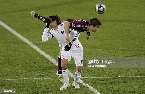 Diego Chaves of the Chicago Fire reacts after colliding with Drew Moor of the Colorado Rapids as they battle for a head ball at Dick's Sporting Goods...