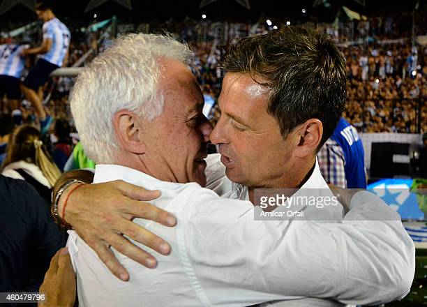 Diego Cocca coach of Racing Club hugs Victor Blanco president of Racing Club celebrating the championship after winning a match between Racing Club...
