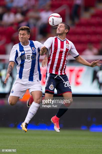 Diego Cortes of Chivas jumps for the ball with Otavio Monteiro of Porto during the friendly match between Chivas and Porto at Chivas Stadium on July...
