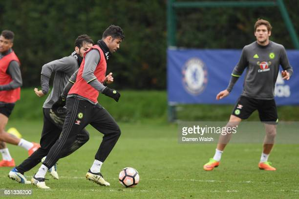 Diego Costa and Cesc Fabregas of Chelsea during a training session at Chelsea Training Ground on March 10 2017 in Cobham England