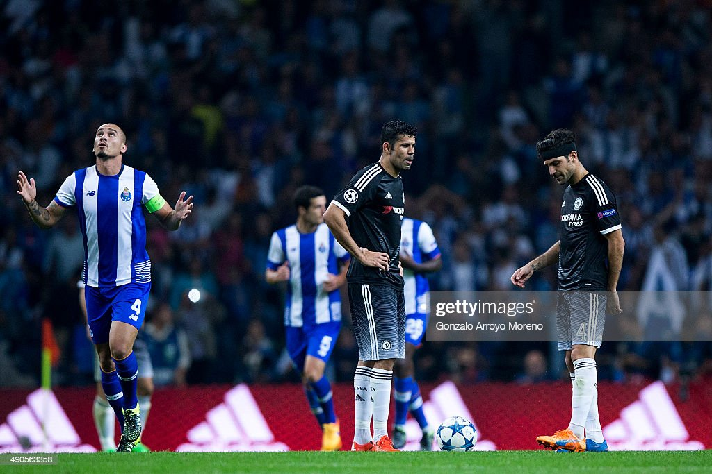 Diego Costa and his teammate Cesc Fabregas react defeated as Maicon Pereira of FC Porto celebrates his team's second goal during the UEFA Champions...