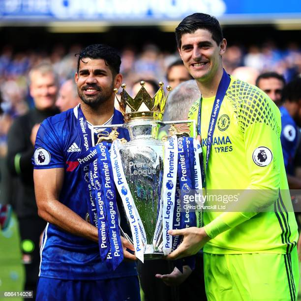 Diego Costa and Thibaut Courtois of Chelsea pose with the Premier League trophy following the Premier League match between Chelsea and Sunderland at...