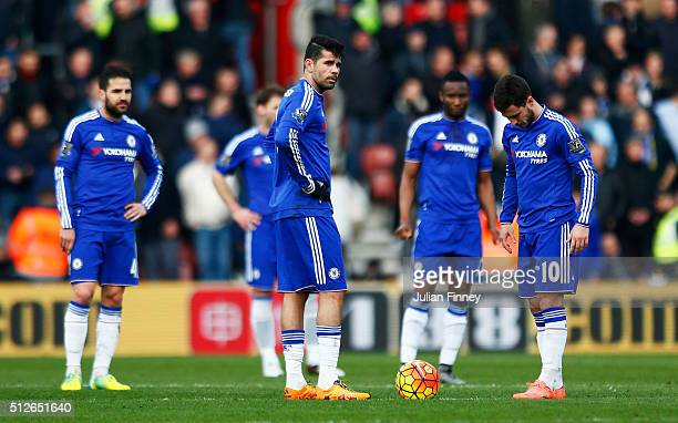 Diego Costa Eden Hazard and Chelsea players react after Southampton's first goal during the Barclays Premier League match between Southampton and...
