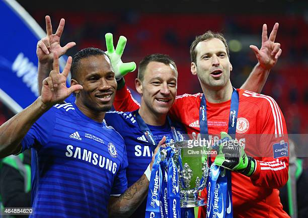 Diego Costa John Terry and Petr Cech of Chelsea pose with the trophy after the Capital One Cup Final match between Chelsea and Tottenham Hotspur at...