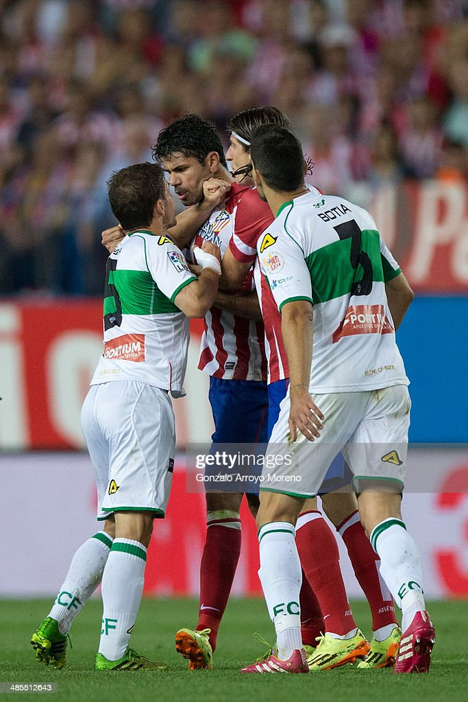 Diego Costa (2L) of Atletico de Madrid argues with <a gi-track='captionPersonalityLinkClicked' href=/galleries/search?phrase=Alberto+Rivera&family=editorial&specificpeople=729112 ng-click='$event.stopPropagation()'>Alberto Rivera</a> (L) of Elche FC and his team mate Alberto Tomas Botia (R) during the La Liga match between Club Atletico de Madrid and Elche FC at Vicente Calderon Stadium on April 18, 2014 in Madrid, Spain.
