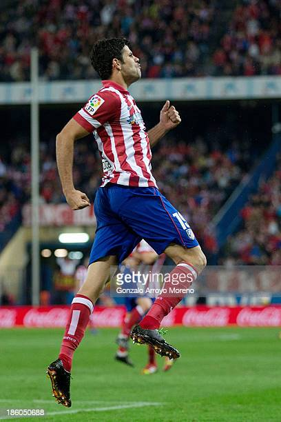 Diego Costa of Atletico de Madrid celebrates after scoring his team's fourth goal during the La Liga match between Club Atletico de Madrid and Real...