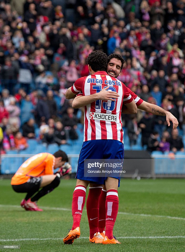 Diego Costa (L) of Atletico de Madrid celebrates after scoring their second goal with teamate Raul Garcia (R) during the La Liga match between Club Atletico de Madrid and Real Valladolid CF at Vicente Calderon Stadium on February 15, 2014 in Madrid, Spain.