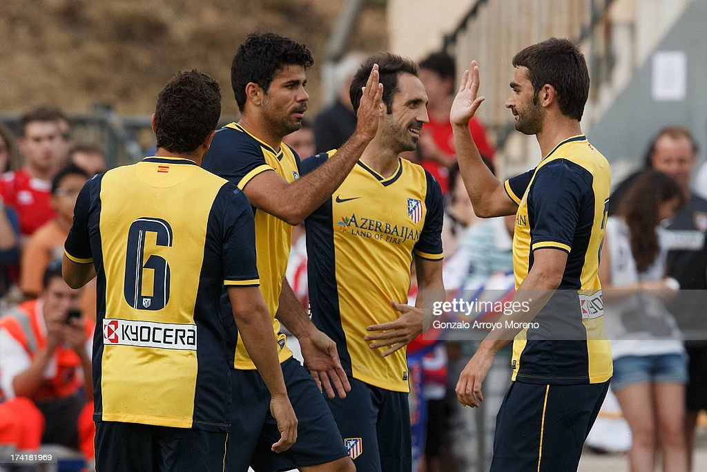 Diego Costa (2nd L) of Atletico de Madrid celebrates scoring their opening goal with teammates during the Jesus Gil y Gil Trophy between Club Atletico de Madrid and Numancia C. D. at Sporting Club Uxama on July 21, 2013 in Burgo de Osma, Soria, Spain.