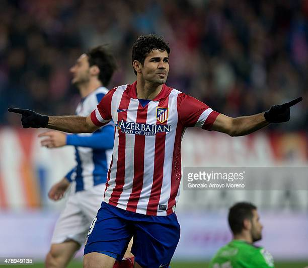 Diego Costa of Atletico de Madrid celebrates scoring their opening goal during the La Liga match between Club Atletico de Madrid and RCD Espanyol at...