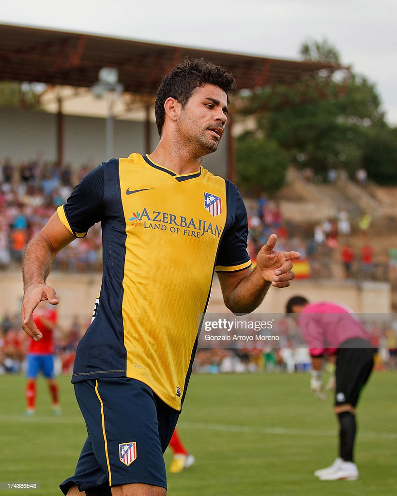 Diego Costa of Atletico de Madrid celebrates scoring their second goal during the Jesus Gil y Gil Trophy between Club Atletico de Madrid and Numancia C. D. at Sporting Club Uxama on July 21, 2013 in Burgo de Osma, Soria, Spain.