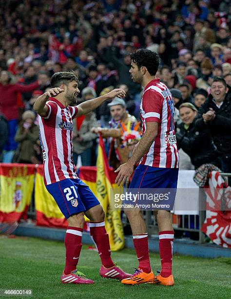 Diego Costa of Atletico de Madrid celebrates scoring their second goal with teammate Diego Ribas during the La Liga match between Club Atletico de...