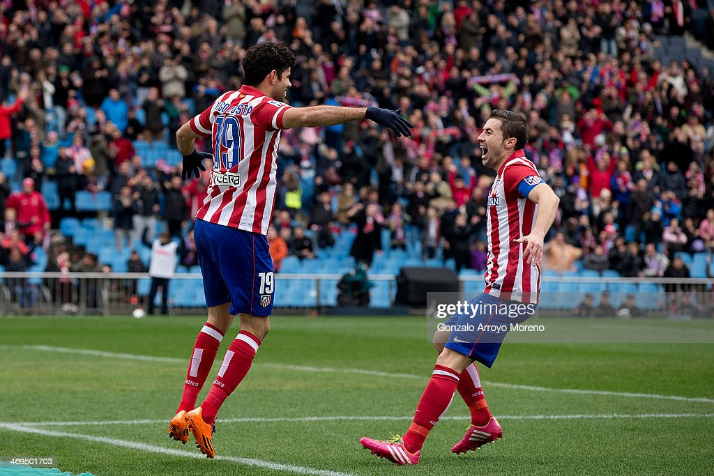 Diego Costa (L) of Atletico de Madrid celebrates scoring their second goal with teammate Gabi Fernandez (R) during the La Liga match between Club Atletico de Madrid and Real Valladolid CF at Vicente Calderon Stadium on February 15, 2014 in Madrid, Spain.