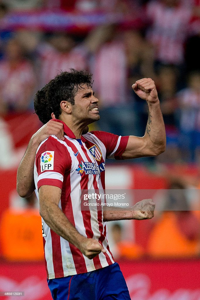 Diego Costa of Atletico de Madrid celebrates scoring their second goal with teammates during the La Liga match between Club Atletico de Madrid and Elche FC at Vicente Calderon Stadium on April 18, 2014 in Madrid, Spain.