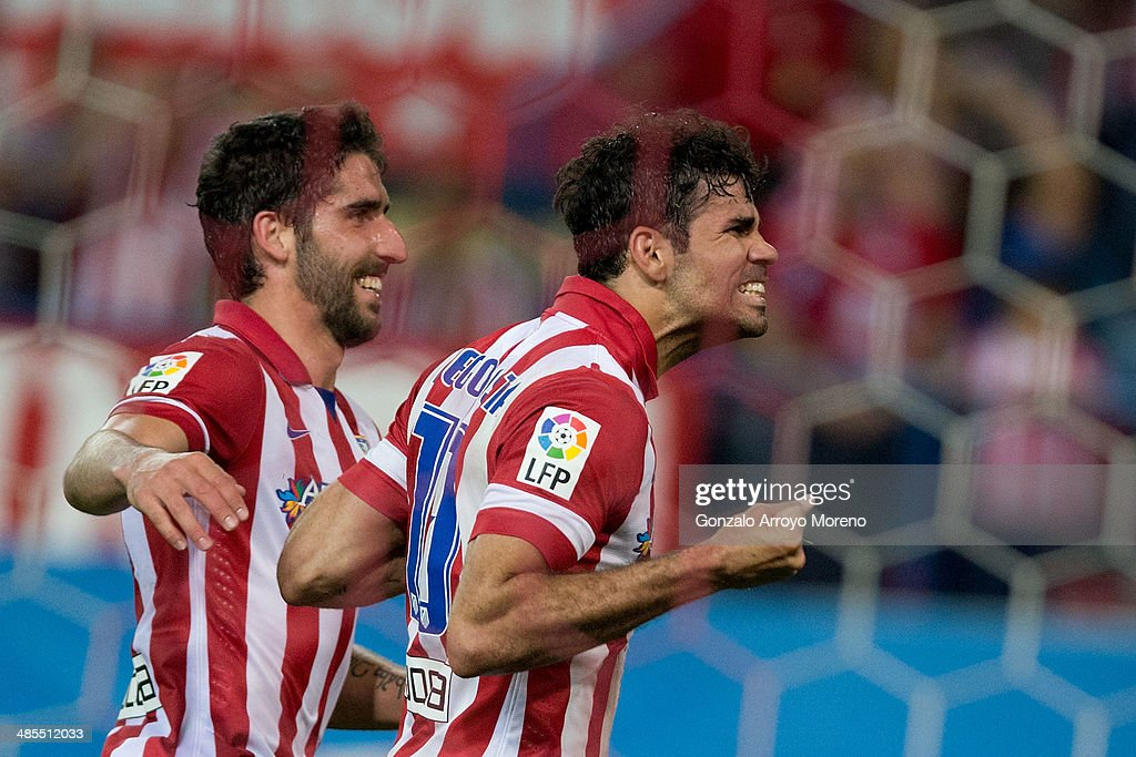 Diego Costa (R) of Atletico de Madrid celebrates scoring their second goal with teammate Raul Garcia (L) during the La Liga match between Club Atletico de Madrid and Elche FC at Vicente Calderon Stadium on April 18, 2014 in Madrid, Spain.