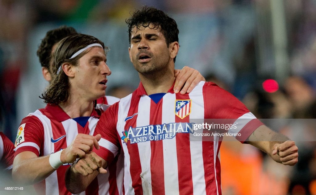 Diego Costa (R) of Atletico de Madrid celebrates scoring their second goal with teammate <a gi-track='captionPersonalityLinkClicked' href=/galleries/search?phrase=Filipe+Luis&family=editorial&specificpeople=3941966 ng-click='$event.stopPropagation()'>Filipe Luis</a> (L) during the La Liga match between Club Atletico de Madrid and Elche FC at Vicente Calderon Stadium on April 18, 2014 in Madrid, Spain.