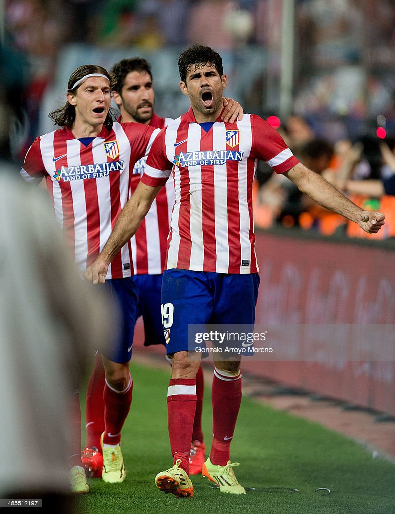 Diego Costa (R) of Atletico de Madrid celebrates scoring their second goal with team mates Raul Garcia (2R) and <a gi-track='captionPersonalityLinkClicked' href=/galleries/search?phrase=Filipe+Luis&family=editorial&specificpeople=3941966 ng-click='$event.stopPropagation()'>Filipe Luis</a> (L) during the La Liga match between Club Atletico de Madrid and Elche FC at Vicente Calderon Stadium on April 18, 2014 in Madrid, Spain.