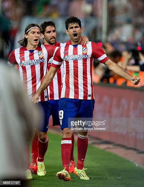 Diego Costa of Atletico de Madrid celebrates scoring their second goal with team mates Raul Garcia and Filipe Luis during the La Liga match between...