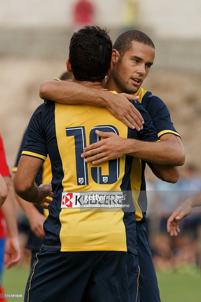 Diego Costa (L) of Atletico de Madrid celebrates with Mario Suarez after scoring their second goal during the Jesus Gil y Gil Trophy between Club Atletico de Madrid and Numancia C. D. at Sporting Club Uxama on July 21, 2013 in Burgo de Osma, Soria, Spain.