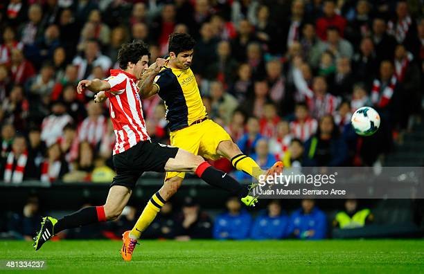 Diego Costa of Atletico de Madrid competes for the ball with Mikel San Jose of Athletic Club during the La Liga match between Athletic Club de Bilbao...