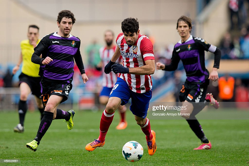 Diego Costa (R) of Atletico de Madrid competes for the ball with Victor Perez (L) of Real Valladolid CF during the La Liga match between Club Atletico de Madrid and Real Valladolid CF at Vicente Calderon Stadium on February 15, 2014 in Madrid, Spain.
